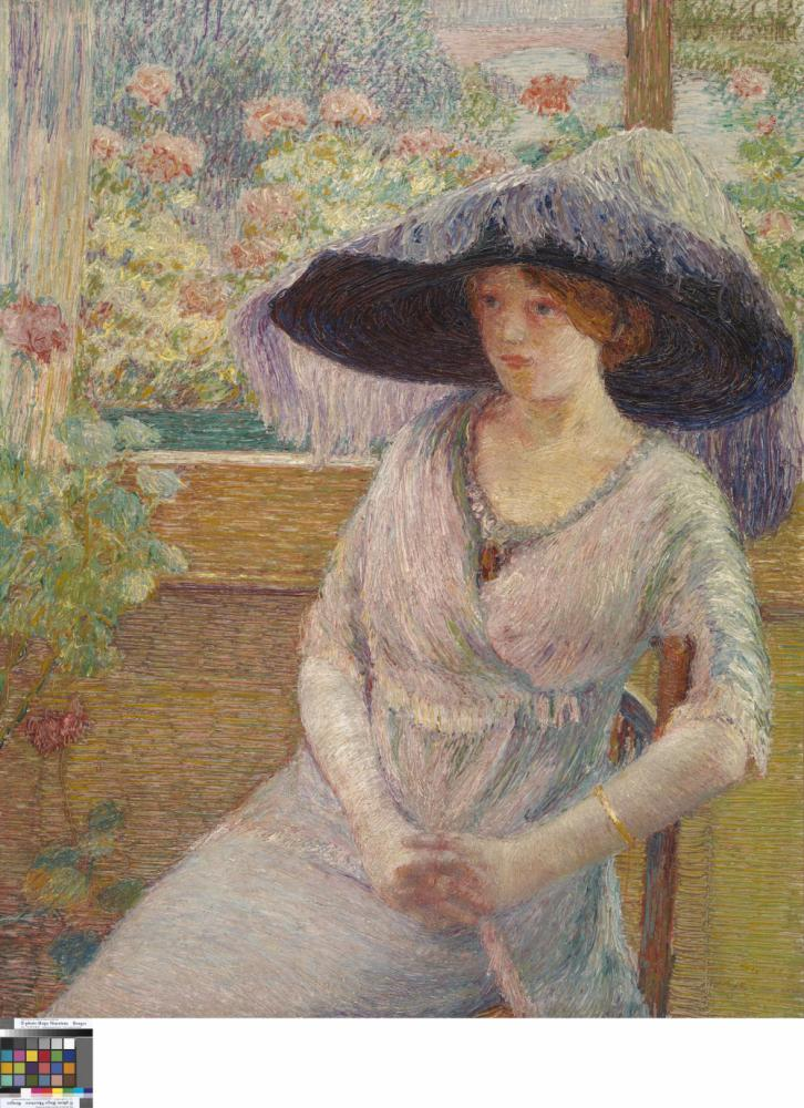 Young girl with black hat.